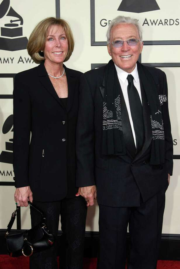 "(FILES)Singer Andy Williams and his wife, Debbie, arrive at the 50th Grammy Awards in Los Angeles in this February 10, 2008 photo. Legendary American crooner Andy Williams, of ""Moon River"" fame, has died, US media reported September 26, 2012. He was 84. Williams, whose fame was at its peak in the 1960s but remained at work into his 80s, succumbed to bladder cancer, his representative told USA Today. A frequent host of the Grammys and Golden Globes, Williams also was known for his television Christmas specials and in later years, a theater he owned in Branson, Missouri. AFP PHOTO/Gabriel BOUYSGABRIEL BOUYS/AFP/GettyImages Photo: GABRIEL BOUYS, AFP/Getty Images / AFP ImageForum"