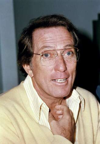 "(FILES) This November 5, 1976 file photo shows US pop singer Andy Williams, during a tour in Great Britain. Legendary American crooner Andy Williams, of ""Moon River"" fame, has died, US media reported September 26, 2012. He was 84. Williams, whose fame was at its peak in the 1960s but remained at work into his 80s, succumbed to bladder cancer, his representative told USA Today. A frequent host of the Grammys and Golden Globes, Williams also was known for his television Christmas specials and in later years, a theater he owned in Branson, Missouri. AFP PHOTO-/AFP/GettyImages Photo: -, AFP/Getty Images / AFP ImageForum"