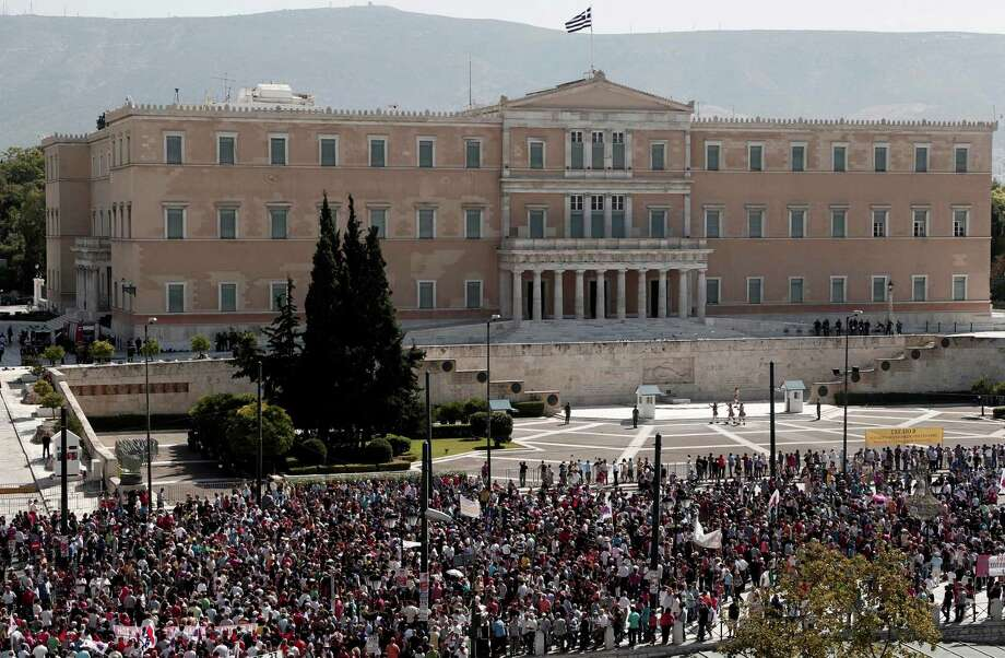 Protesters of the Greek Communist party affiliated unions march in front of the Greek Parliament in Athens Wednesday Sept. 26, 2012. Greek workers walked off the job Wednesday for the first general strike since the country's coalition government was formed in June, as the prime minister and finance minister hammered out a package of euros 11.5 billion ($14.87 billion) in spending cuts. Photo: Dimitri Messinis, AP / AP