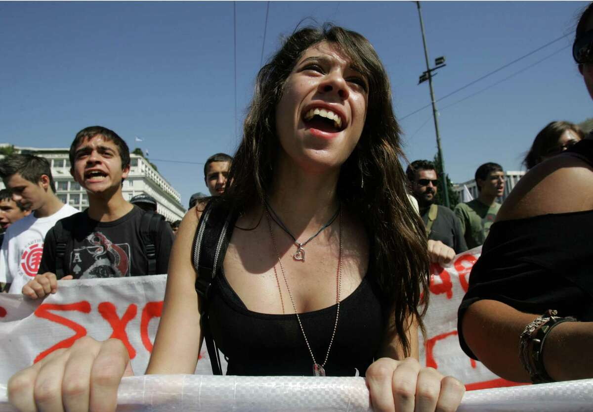 GREECE, ATHENS - SEPTEMBER 26: Students shout slogans again the government on Syntagma Square during a 24-hour labour strike September 26, 2012 in Athens, Greece. Today marks Greece's first big anti-austerity strike since the coalition government took power in June.