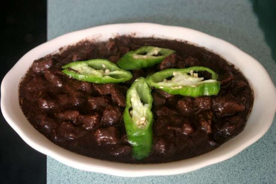 Don't be fooled by its cutesy nickname, chocolate pudding. Dinuguan is a blood stew from the Philippines. (AP Photo/Howie Rumberg) (AP)