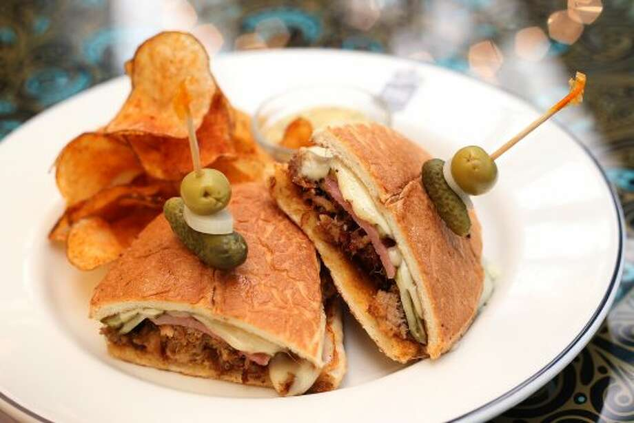 The Havana Cubano from Ocho at Hotel Havana on Wednesday, Apr. 18, 2012. The hot-pressed sandwich is stuffed with slow-roasted pork shoulder seasoned with orange juice, achiote paste, griddled ham and Swiss cheese. Kin Man Hui/Express-News. (San Antonio Express-News)