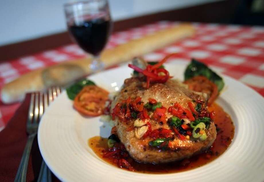A serving of Pork Chop with sundried mushroom risoto with a sauce of red bell pepper jelly at Tolentino's Italian Kitchen, April 25, 2012. Bob Owen (San Antonio Express-News)