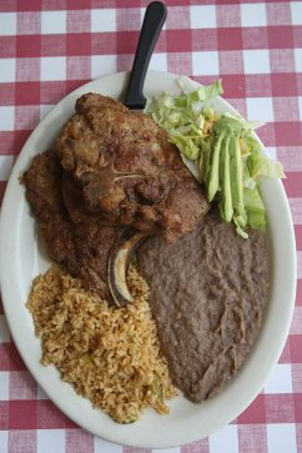 Pork chop taco combo plate with rice and beans is a popular dish at Angel's Mexican Haven Monday June 11, 2012. (San Antonio Express-News)