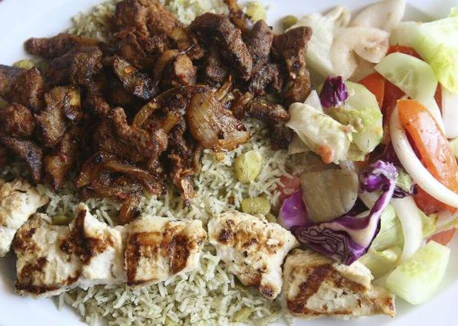 Combo plate with gyro pork and chicken kebab and green rice Monday July 23, 2012 at Casa del Kabob. (SAN ANTONIO EXPRESS-NEWS)