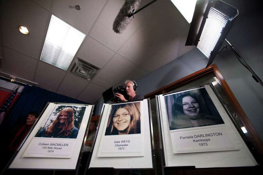 Photos of murder victims are displayed during a news conference in Surrey, British Columbia, Canada on Tuesday, Sept 25, 2012. Canadian police have linked a dead U.S. convict to one of 18 women who vanished along three highways in British Columbia over several decades, and authorities are investigating the man for possible links to five murders in the U.S. The Royal Canadian Mounted Police said Bobby Jack Fowler, who died in 2006, is a person of interest in 10 of the Canadian cases, and DNA has linked Fowler to the 1974 killing of teenage hitchhiker Colleen MacMillen. (AP Photo/The Canadian Press, Jonathan Hayward) Photo: Jonathan Hayward, SUB