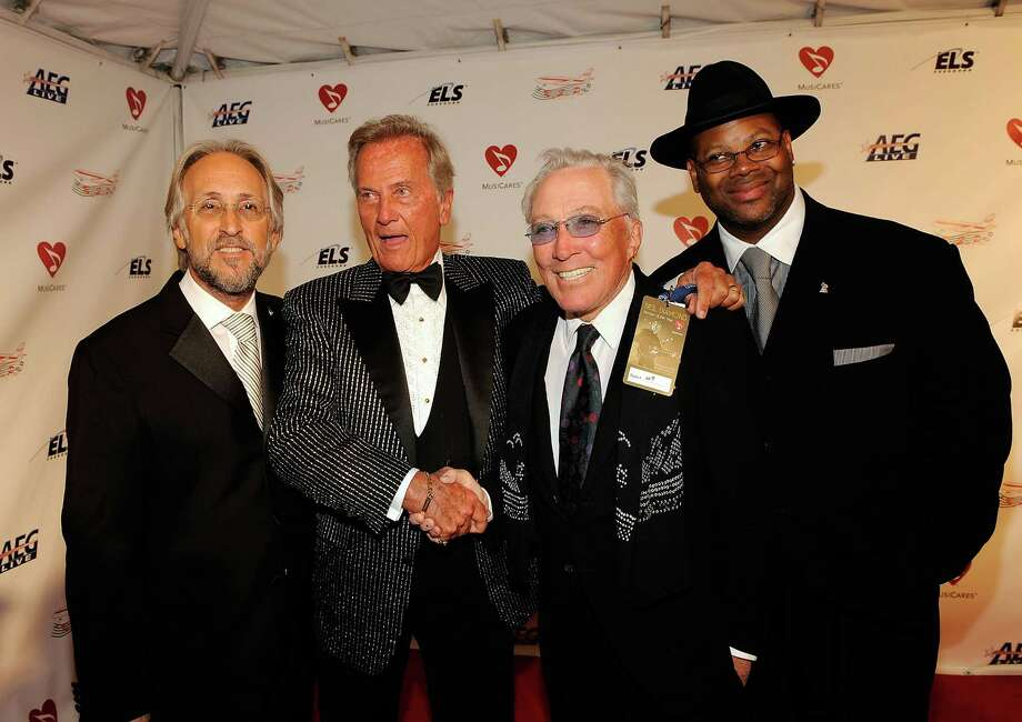 LOS ANGELES, CA - FEBRUARY 06:  (L-R) President/CEO of The Recording Academy Neil Portnow, singers Pat Boone, Andy Williams, and producer Jimmy Jam arrive at the 2009 MusiCares Person of the Year Tribute to Neil Diamond at the Los Angeles Convention Center on February 6, 2009 in Los Angeles, California.  (Photo by Larry Busacca/Getty Images) *** Local Caption *** Andy Williams;Andy Williams;Pat Boone;Jimmy Jam Photo: Larry Busacca, Getty Images / 2009 The Recording Academy