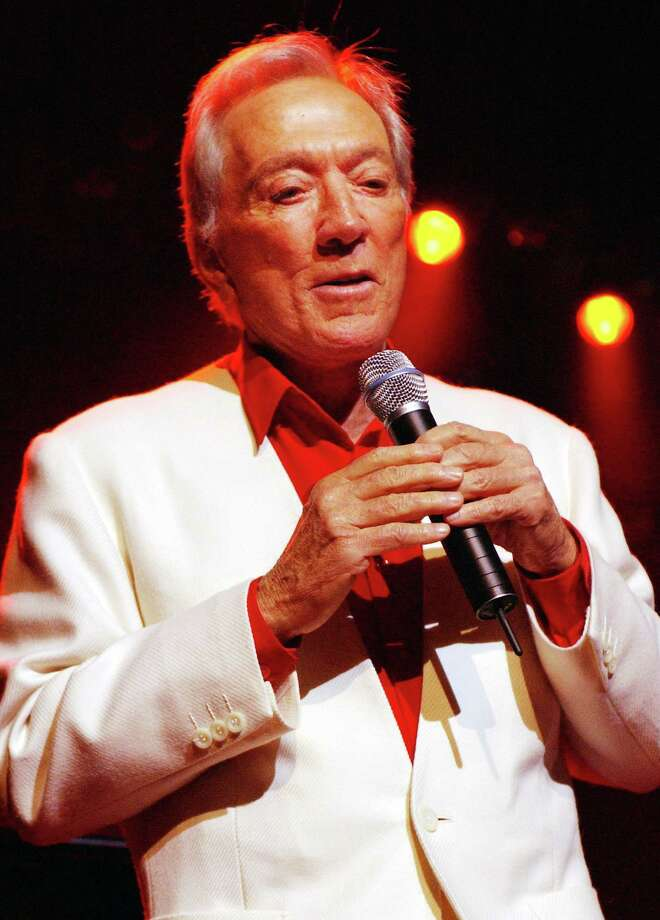 LONDON - JULY 1:  Singer Andy Williams performs under red stage lights at Royal Albert Hall during his tour of the United Kingdom July 1, 2002 in London, England. Photo: John Li, Getty Images / 2002 Getty Images