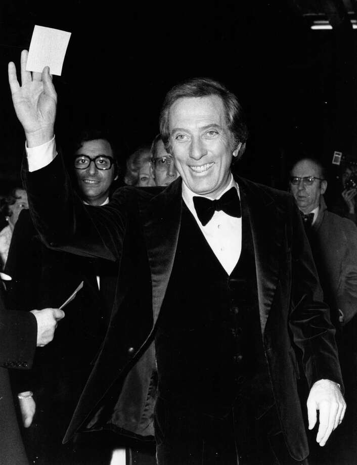 14th December 1976:  Popular American singer Andy Williams arrives at the Talk Of The Town in London's Leicester Square for a charity cabaret show, in which he stars with Danny LaRue and Frankie Vaughan. The show is in aid of the St John's Ambulance Association and their patron the Queen will be in attendance. Photo: Peter Cade, Getty Images / Hulton Archive