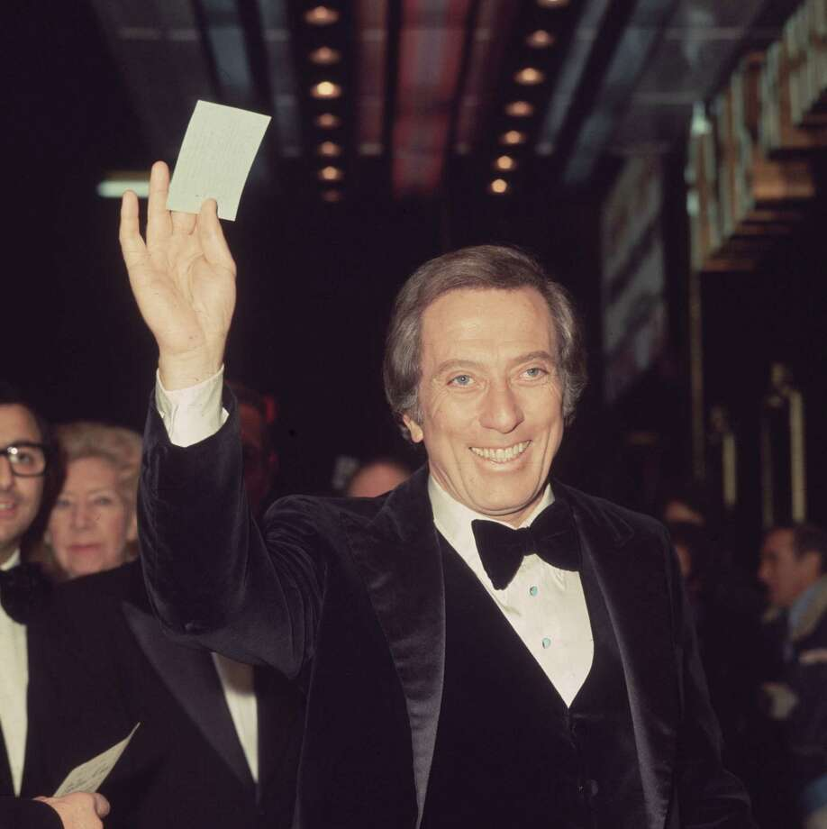 14th December 1976:  Popular American singer Andy Williams arrives at the Talk Of The Town in London's Leicester Square for a charity cabaret show, in which he stars with Danny LaRue and Frankie Vaughan. The show is in aid of the St John's Ambulance Association and their patron the Queen will be in attendance. Photo: Fox Photos, Getty Images / Hulton Archive
