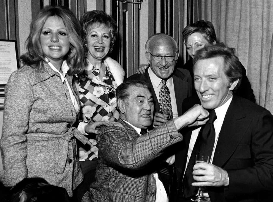 30th April 1974:  American boxer Jack Dempsey (1895 - 1983)  'chins' popular singer Andy Williams in London. Photo: Central Press, Getty Images / Hulton Archive