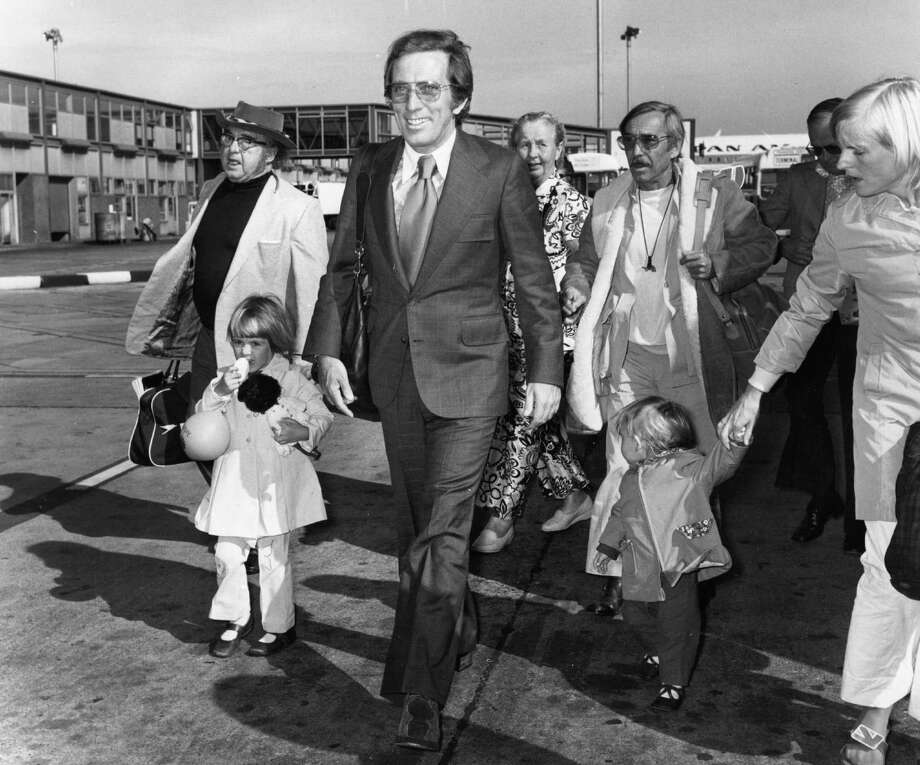 July 1972:  Popular American singer Andy Williams amongst travellers on the runway at Heathrow Airport. Photo: Evening Standard, Getty Images / Hulton Archive