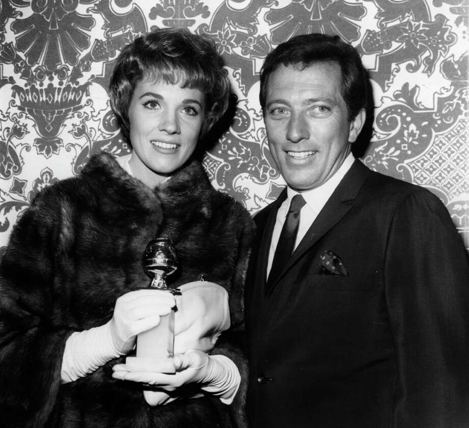 American singer Andy Williams with British singer and actress Julie Andrews. They are in Hollywood for the Golden Globe Awards, where Julie has been nominated for an award and Andy will be master of ceremonies. Photo: Keystone, Getty Images / Hulton Archive
