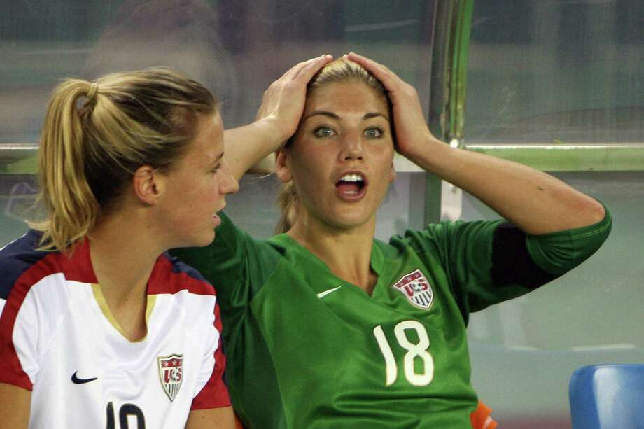 Replaced US goalkeeper Hope Solo, right, sits on the bench with teammate Aly Wagner before losing their 2007 FIFA Women's World Cup football tournament semi-final match 4-0 to Brazil at the Dragon Stadium in Hangzhou, 27 September 2007. Solo was replaced by veteran US goalkeeper Briana Scurry in the lead up to the game. Photo: MARK RALSTON, AFP/Getty Images / 2007 AFP