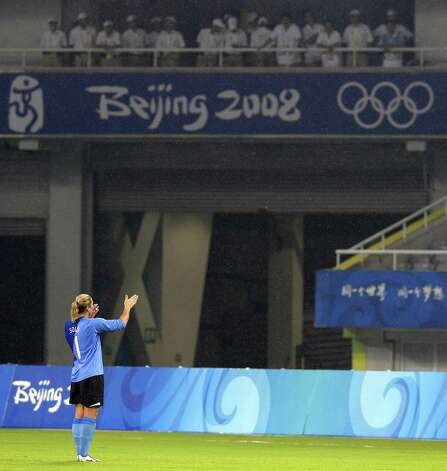 The US goalkeeper Hope Solo blows kisses to the spectators after the 2008 Beijing Olympic Games women's quarter-final football match between Canada and the US at the Shanghai Stadium on August 15, 2008. The US defeated Canada 2-1 with a decisive goal in extra time to advance into the semifinals. Photo: LIU JIN, AFP/Getty Images / 2008 AFP