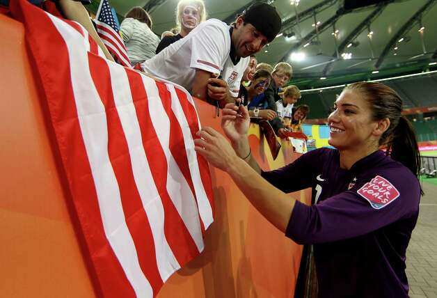 Hope Solo of USA signs autographs after the FIFA Women's World Cup 2011 Group C match between Sweden and USA at the Arena In Allerpark on July 6, 2011, in Wolfsburg, Germany. Photo: Scott Heavey, Getty Images / 2011 Getty Images