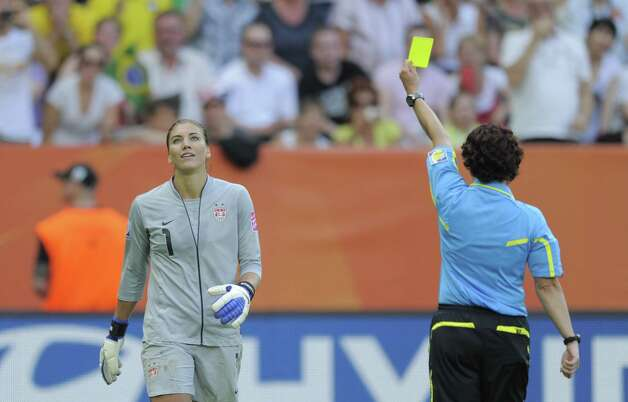 Referee Jacqui Melksham, right, shows the yellow card to USA's goalkeeper Hope Solo during the quarter-final match of the FIFA women's football World Cup Brazil vs USA on July 10, 2011, in Dresden, eastern Germany. Photo: ROBERT MICHAEL, AFP/Getty Images / 2011 AFP