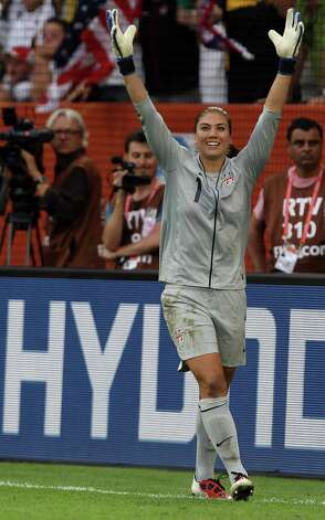 Hope Solo, goalkeeper of USA, celebrates after she saves a penalty during penalty shoot-out during the FIFA Women's World Cup 2011 Quarter Final match between Brazil and USA at Rudolf-Harbig-Stadion on July 10, 2011, in Dresden, Germany. Photo: Martin Rose, Getty Images / 2011 Getty Images