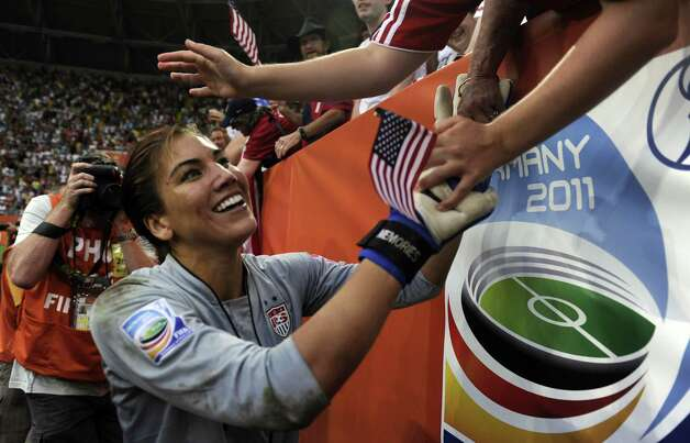 USA's goalkeeper Hope Solo celebrates with supporters after the quarter-final match of the FIFA women's football World Cup Brazil vs USA on July 10, 2011, in Dresden, eastern Germany.  Brazil drew 2-2 with the USA but lost 5-3 on penalties. Photo: ODD ANDERSEN, AFP/Getty Images / 2011 AFP
