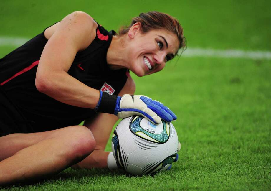 USA's goalkeeper Hope Solo saves the ball during a training session, one day ahead of the FIFA women's football World Cup final match Japan vs USA at the FIFA Frauen-WM-Stadium in Frankfurt/Main, central Germany, on July 16, 2011. Photo: JOHANNES EISELE, AFP/Getty Images / 2011 AFP