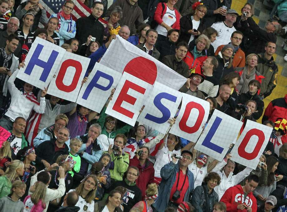Supporters of the USA hold posters with the name of USA's goalkeeper Hope Solo during the FIFA Women's Football World Cup final match of Japan vs USA on July 17, 2011, in Frankfurt/M., western Germany. Japan won 3-1 in a penalty shoot-out after the final had finished 2-2 following extra-time. Photo: DANIEL ROLAND, AFP/Getty Images / 2011 AFP
