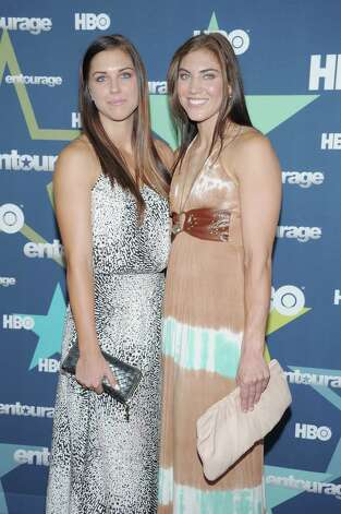 Professional soccer players Alex Morgan, left, and Hope Solo attend the Entourage Season 8 premiere at the Beacon Theatre on July 19, 2011, in New York City. Photo: Michael Loccisano, Getty Images / 2011 Getty Images