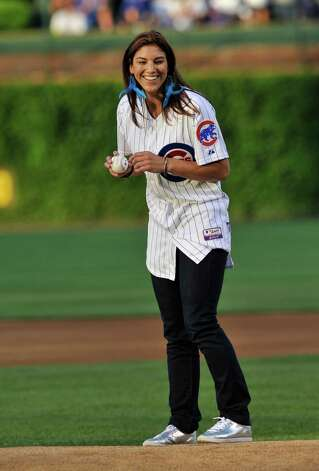 U.S. women's goalkeeper Hope Solo throws out the first pitch before the Chicago Cubs vs St. Louis Cardinals game on August 21, 2011, at Wrigley Field in Chicago, Illinois. Photo: David Banks, Getty Images / 2011 Getty Images