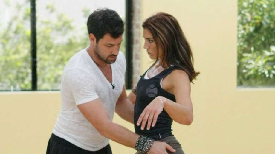 Hope Solo and partner Maksim Chmerkovskiy rehearse for the two-hour season premiere of Dancing with the Stars.