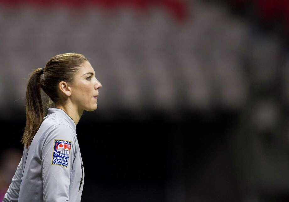 Hope Solo of the United States watches her team play in front of her during second half action against Mexico at the 2012 CONCACAF Women's Olympic Qualifying Tournament at BC Place on Jan. 24, 2012, in Vancouver, British Columbia, Canada. Photo: Rich Lam, Getty Images / 2012 Getty Images