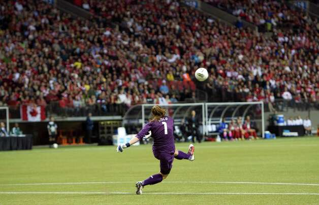 Goalkeeper Hope Solo of the United States kicks the ball back into play during first half of championship action against Canada at the 2012 CONCACAF Women's Olympic Qualifying Tournament at BC Place on Jan/ 29, 2012, in Vancouver, British Columbia, Canada. Photo: Rich Lam, Getty Images / 2012 Getty Images