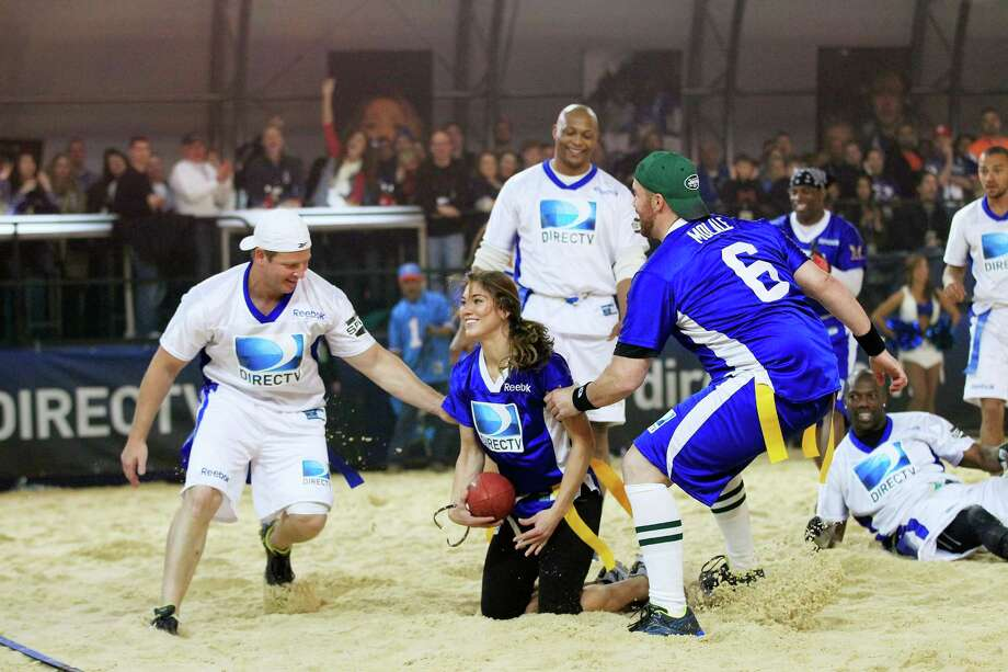 Soccer player Hope Solo, center, plays on Team Palladia HD at DIRECTV's Sixth Annual Celebrity Beach Bowl Game at Victory Field on Feb. 4, 2012, in Indianapolis, Ind. Photo: Chris Trotman, Getty Images For DirecTV / 2012 Getty Images