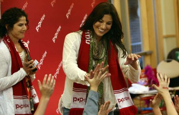 Soccer player Hope Solo meets with youngsters on Friday, June 22, 2012, at the Laurelhurst Community Center in Seattle. Solo met with the kids as part of a program organized by PopChips.