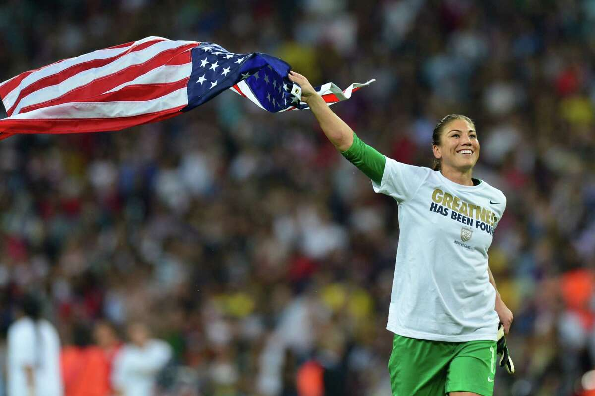 United States's goalkeeper Hope Solo celebrates with the U.S. flag after the final of the women's soccerl competition of the London 2012 Olympic Games versus Japan on Aug. 9, 2012, at Wembley stadium in London. The US team defeated Japan 2-1 to win the gold medal.
