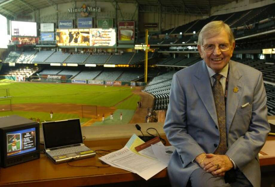 Houston Astros Hall of Fame broadcaster Milo Hamilton poses in the his radio booth in 2005.  (MELISSA PHILLIP / HOUSTON CHRONICLE)