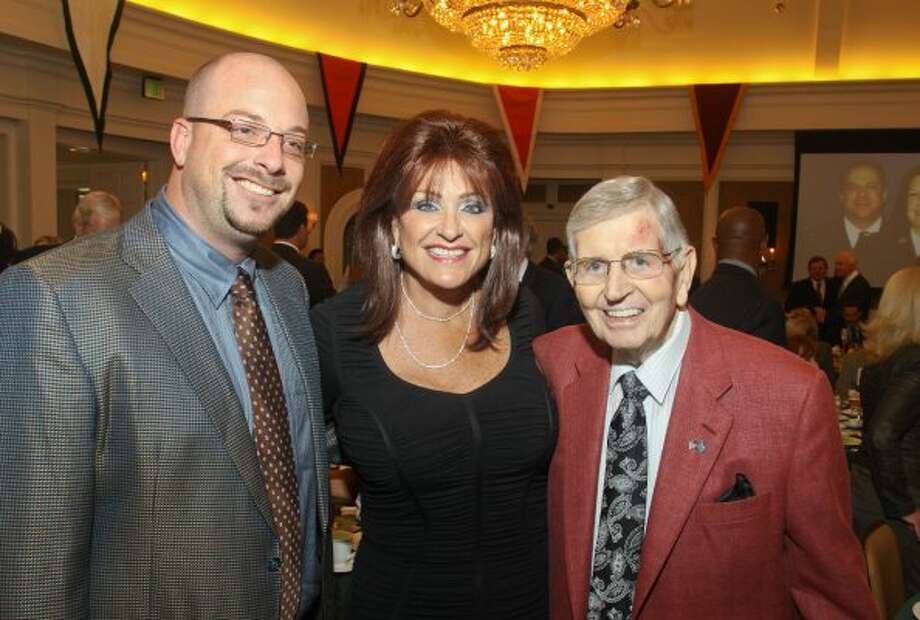 Brian Faulk, from left, Carolyn Faulk and Milo Hamilton at a society event. (Gary Fountain / For the Chronicle)