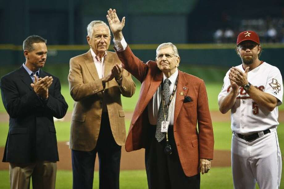Milo Hamilton is recognized for 65 years of broadcasting, and his 83rd birthday, by Craig Biggio, Drayton McLane and Jeff Bagwell before the start of the Houston Astros in 2010. (Michael Paulsen / Chronicle)
