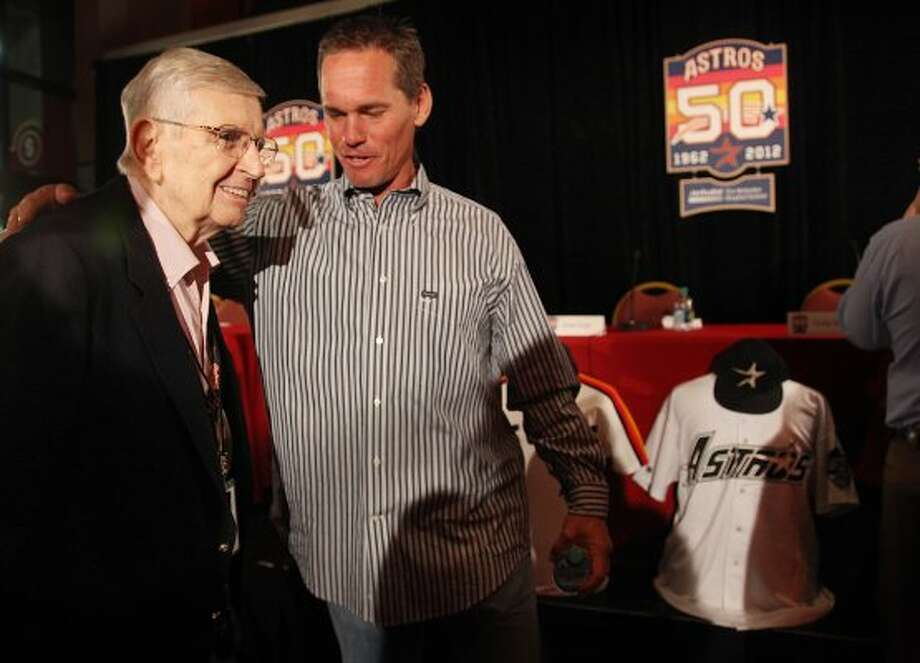 Astros Hall of Fame radio announcer Milo Hamilton greets former Astros player Craig Biggio after the unveiling of the 50th Anniversary logo at Minute Maid Park on Sept. 22, 2011. (Mayra Beltran / Houston Chronicle)