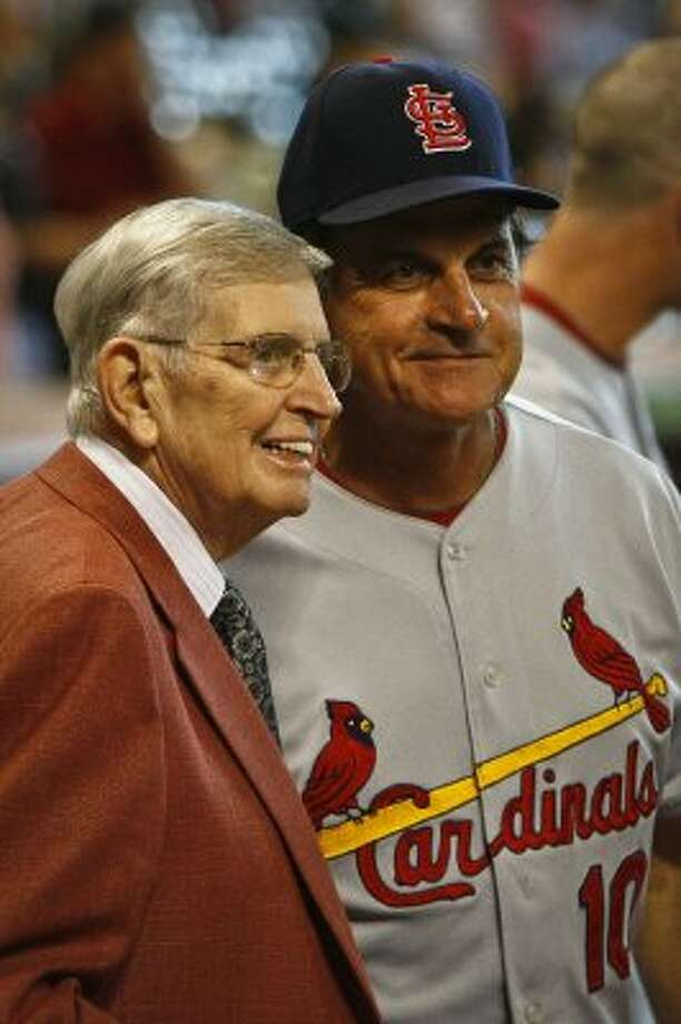 Milo Hamilton is greeted by Cardinals' Manager Tony La Russa after Hamilton was recognized for 65 years of broadcasting in 2010. (Michael Paulsen / Chronicle)