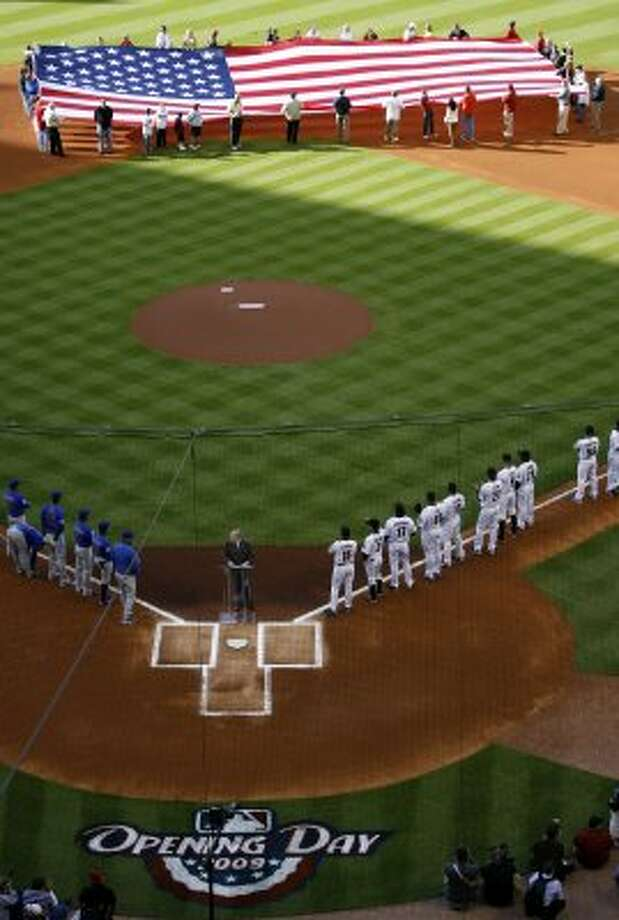 Milo Hamilton hosts the team roll call before the start of the Houston Astros' home opener in 2009. (Karen Warren / Houston Chronicle)