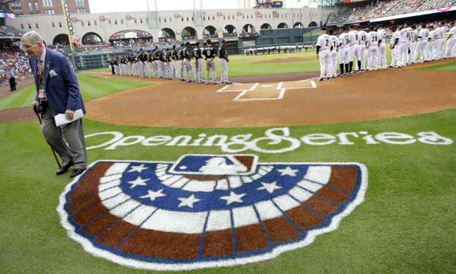 Milo Hamilton walks off the field after opening day ceremonies with team introductions before the start of the Astros home opener in 2011. (Karen Warren / Houston Chronicle)