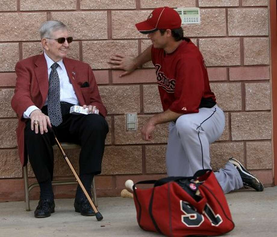 Hall of Fame broadcaster, Milo Hamilton chats with Houston Astros infielder Koby Clemens (91) outside of the clubhouse during the Houston Astros spring training at their facility in 2011. (Karen Warren / Houston Chronicle)