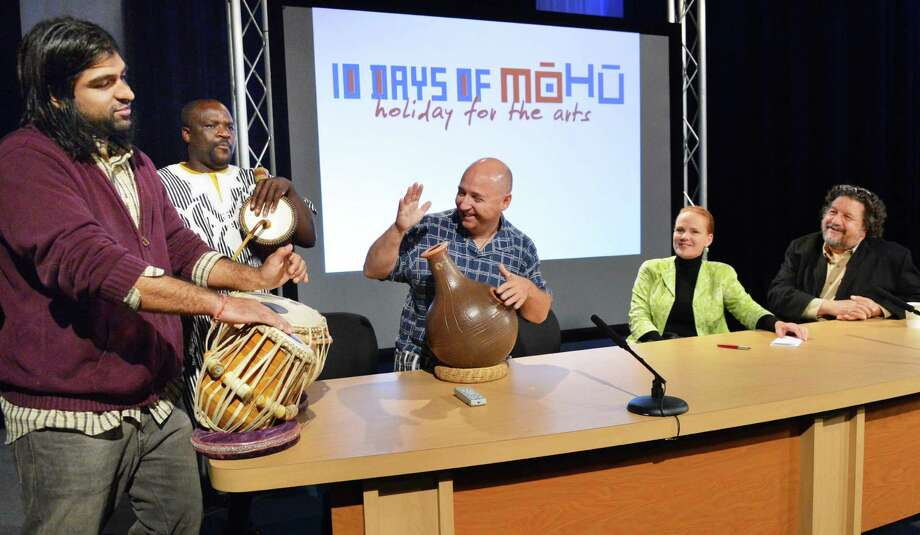 Percussionists, from left, Devesh Chandra, Zorkie Nelson and Brian Melick join SaratogaArtsFest's Mary Ellen O'Loughlin and Proctor's Philip Morris, at right, to launch the second annual MoHu festival during a news conference at WMHT studios in Troy Tuesday Sept. 18, 2012. The MOHU festival returns for ten days this October, celebrating the arts throughout the greater Capital Region. Beginning Friday, October 5, more than 100 venues, artists, and arts organizations from all over Albany, Schenectady, Rensselaer, and Saratoga counties band together to display the strength and diversity of the cultural programming that makes this area so special.  (John Carl D'Annibale / Times Union) Photo: John Carl D'Annibale / 00019269A