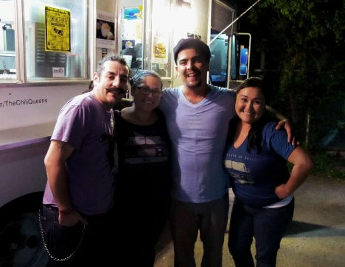 Chef Aquiles Chavez, Aaron Sanchez and Ana Fernandez, owner of The Institute of Chili and worker Adrea Figueroa pose for photos after filming./Courtesy of the Institute of Chili