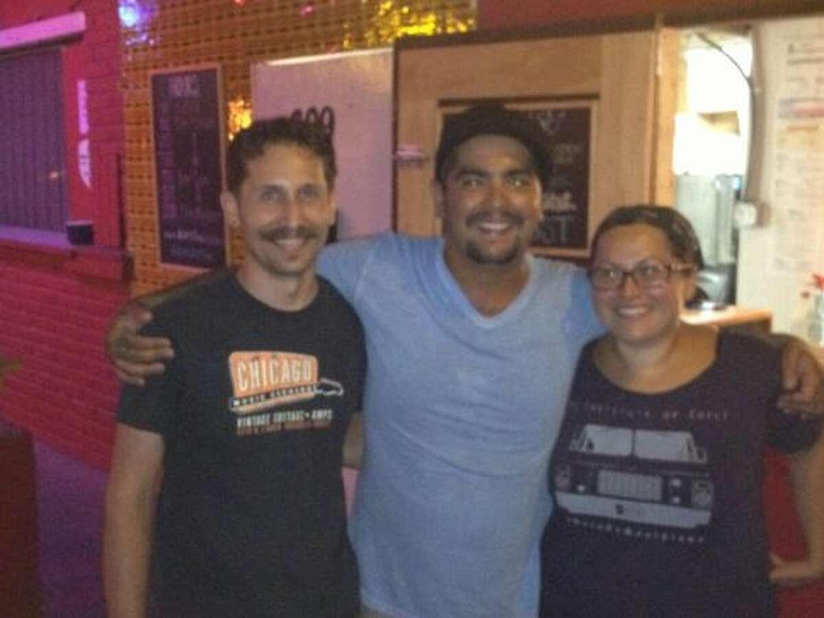 An Alamo Street Eat Bar employee, Aaron Sanchez and Ana Fernandez pose for a picture./Courtesy of Alamo Street Eat Bar