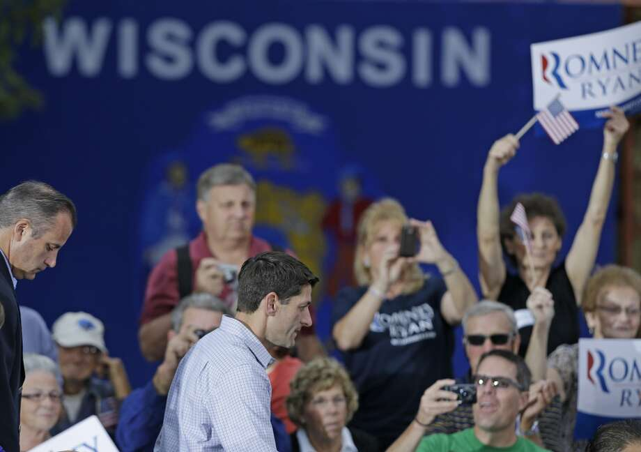 Republican Vice Presidential candidate  Rep. Paul Ryan, R-Wis, leaves the stage after apprearing with presidential candidate Mitt Romney during a welcome home rally Sunday, Aug., 12, 2012 in Waukesha, Wis. (AP Photo/Jeffrey Phelps) (JEFFREY PHELPS / Associated Press)