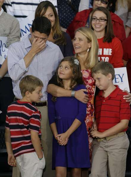 Vice presidential running mate Rep. Paul Ryan, R-Wis,left, fights back tears with his family at his