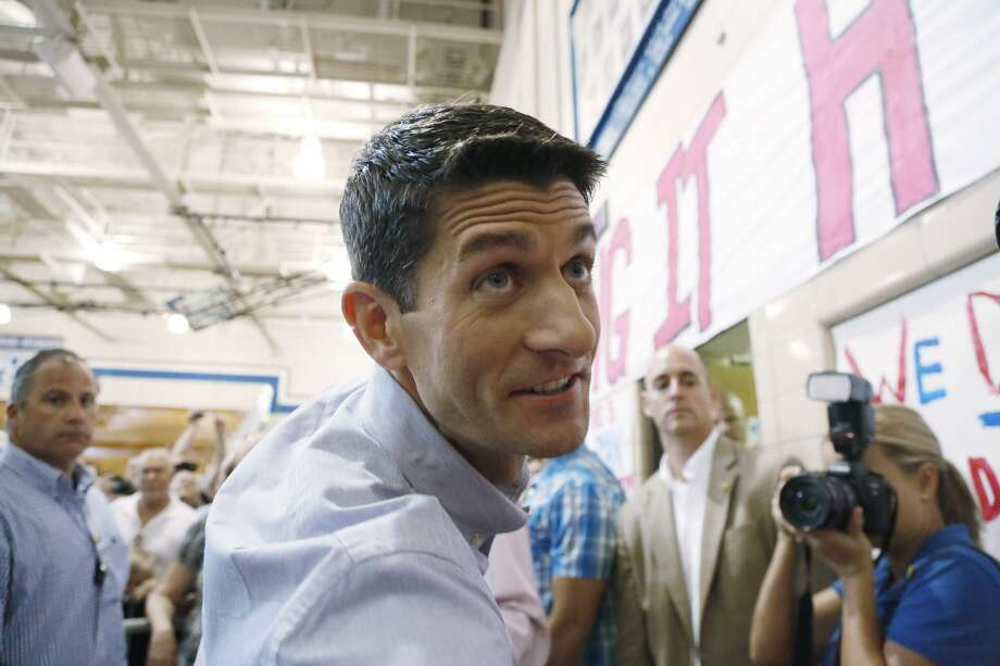 "JANESVILLE, WI - AUGUST 27:  The presumptive vice presidential candidate U.S. Rep. Paul Ryan (R-WI) shakes hands during a ""Send-Off"" rally August, 27, 2012 in Janesville, Wisconsin. Ryan and presumptive presidential candidate and former Massachusetts Gov. Mitt Romney will be on their way to Tampa, Florida for the Republican National Convention. The convention was gaveled open August 27 and immediately recessed until tomorrow because of Tropical Storm Isaac.  (Photo by Jeffrey Phelps/Getty Images) (Jeffrey Phelps / Getty Images)"