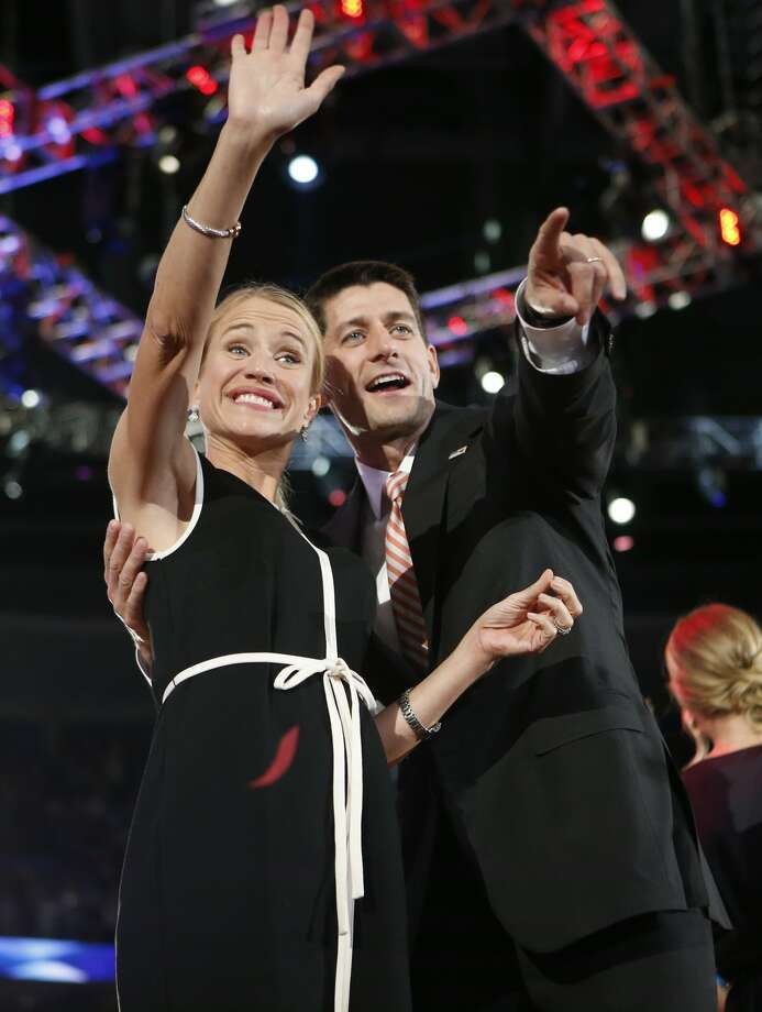 Republican vice presidential nominee, Rep. Paul Ryan and his wife Janna wave to delegates during the Republican National Convention in Tampa, Fla., on Thursday, Aug. 30, 2012. (AP Photo/Jae C. Hong) (Associated Press)