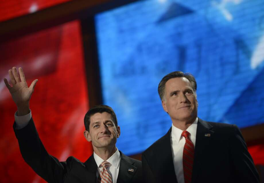 Republican presidential candidate Mitt Romney (R) and Vice presidential nominee Paul Ryan wave at the Tampa Bay Times Forum in Tampa, Florida, on August 30, 2012 on the final day of the Republican National Convention (RNC). The RNC culminates today with the formal nomination of Mitt Romney and Paul Ryan as the GOP presidential and vice-presidential candidates in the US presidential election.   AFP PHOTO Brendan SMIALOWSKIBRENDAN SMIALOWSKI/AFP/GettyImages (AFP/Getty Images)