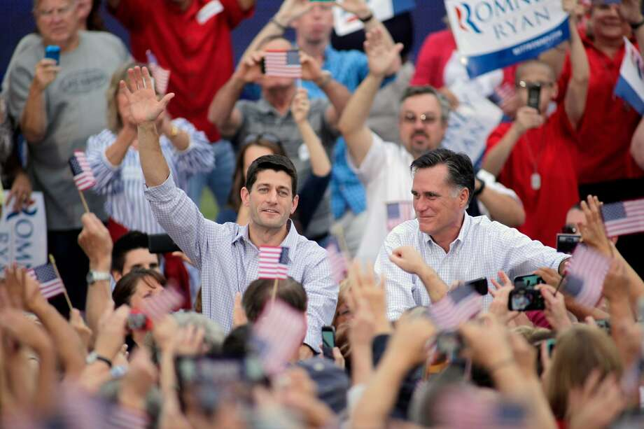 WAUKESHA, WI - AUGUST 12: Republican presidential candidate and former Massachusetts Gov. Mitt Romney and vice presidential candidate and Wisconsin native Rep. Paul Ryan (R-WI) (L) greet supporters during a campaign event at the Waukesha Expo Center on August 12, 2012 in Waukesha, Wisconsin. Romney continues his four day bus tour a day after announcing his running mate, Rep. Paul Ryan. (Photo by Darren Hauck/Getty Images) (Darren Hauck / Getty Images)